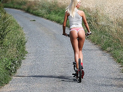 Nude Hungarian babe Tracy Gold rides a bicycle and masturbates outdoors