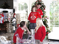 Kinky Riley May jacks off stebro's cock and rides it by the X-Mas tree
