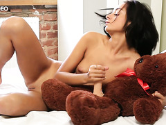 Naughty Inga puts on a strapon on her teddy bear and fucks it