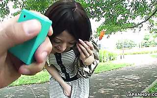 Mitsuki walks in park with vibrator in her panties and gives head in a car