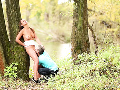 Delightful Naomi Bennet enjoys sex by the lake in a forest