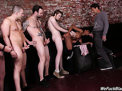 Ebony Lacey London gets a bukkake treatment in the end of interracial gangbang