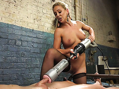 Cherie DeVille jacks off slave's cock with giant fleshlight and rides face strapon