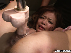 Enslaved Japanese babe Aya Amamiya is dildoed brutally