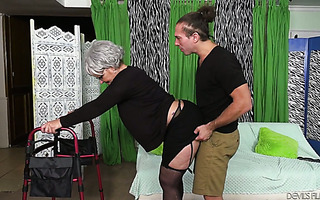 Phat ass granny Kelly Leigh holds on walker while being fucked