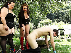 Fat mistresses own tiny slave boy in the forest