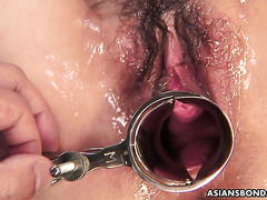 Rina Serizawa is coated in candle wax and stretched out with speculum