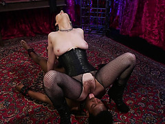Mistress Cherry Torn is facesitting and smothering black slave