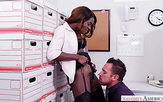 Ebony accountant Ana Foxxx fucks white coworker in archive office