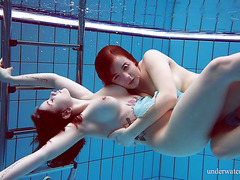 Busty teens Dashka and Vesta caress each other underwater
