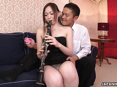 Flutist Kana Sasaki is squirting on teacher's fingers
