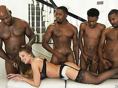 Mature Britney Amber multitasks in interracial DP gangbang