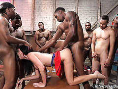 British porn babe Jasmine Jae is fucked and jizzed by gang of black homies