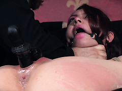 Tied up and gagged Mandy Muse gets chocked and ass toyed