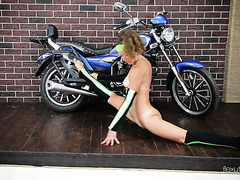 Super flexy Ninka does acrobatic tricks by the bike