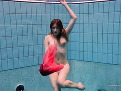 Hot lady takes her lovely red dress and shows her body underwater