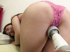 Dude toys Nana Aiba with a magic wand and deposits cum into her hairy cunt