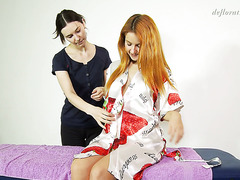 Skilled masseuse treats hot Russian virgin Roberta Berti with massage